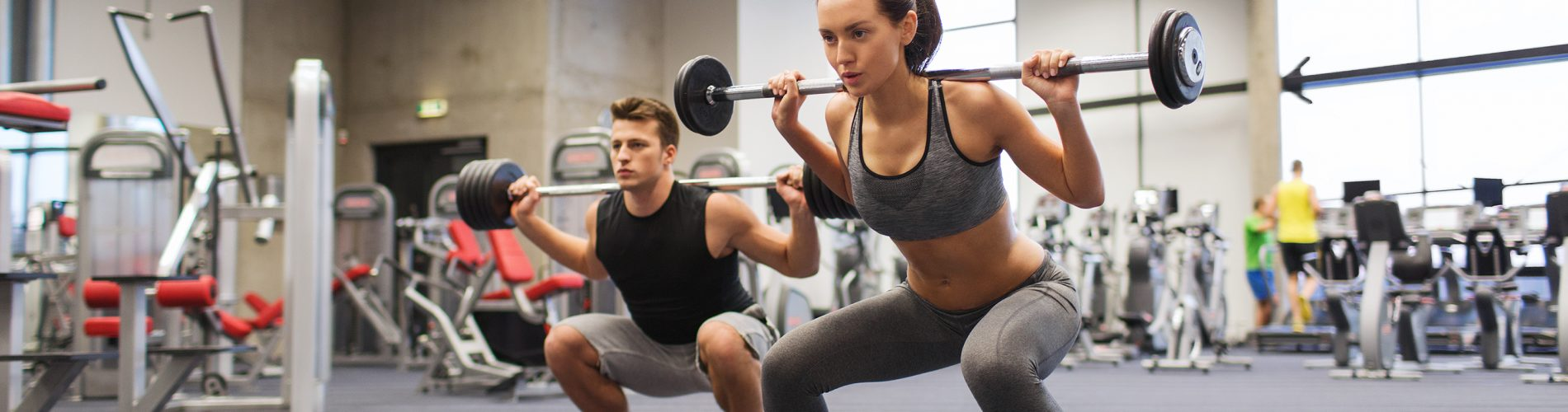 Man and Woman doing Squats - Simply Gym